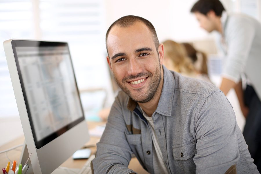 bigstock Cheerful guy sitting in front 53542399 1 - Importance of Wellbeing in the Workplace