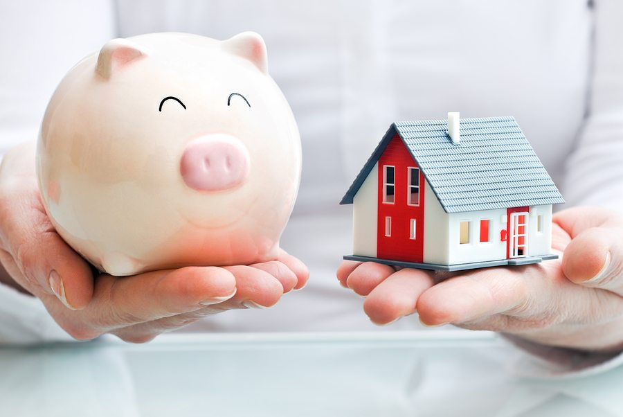 bigstock Hands Holding A Piggy Bank An 42819019 2 1 - Save Money with Home Insurance Credits