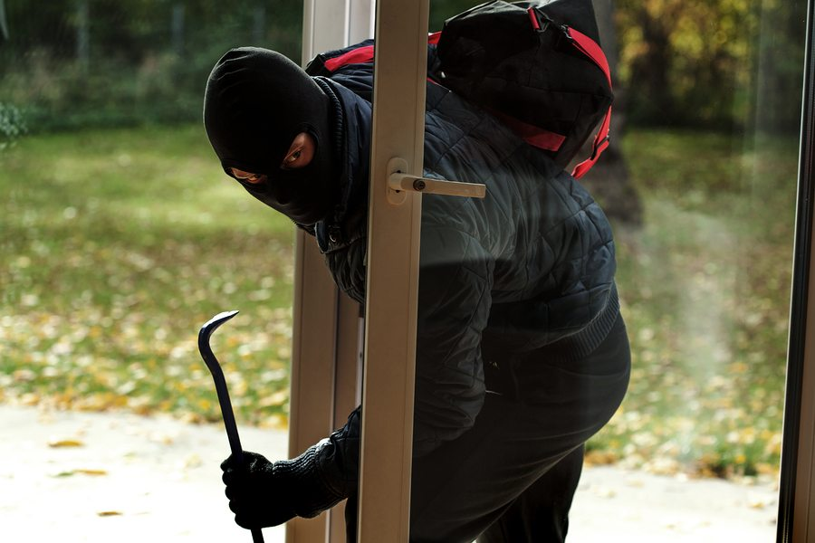 bigstock Burglar Entering To House 59237540 - Defend Your Home Against Burglaries and Home Invasions
